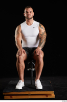 Grigory  1 camo shorts dressed sitting sports white sneakers white tank top whole body 0007.jpg